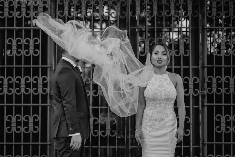 artistic portrait of bride an groom at Los Angeles River Center & Gardens