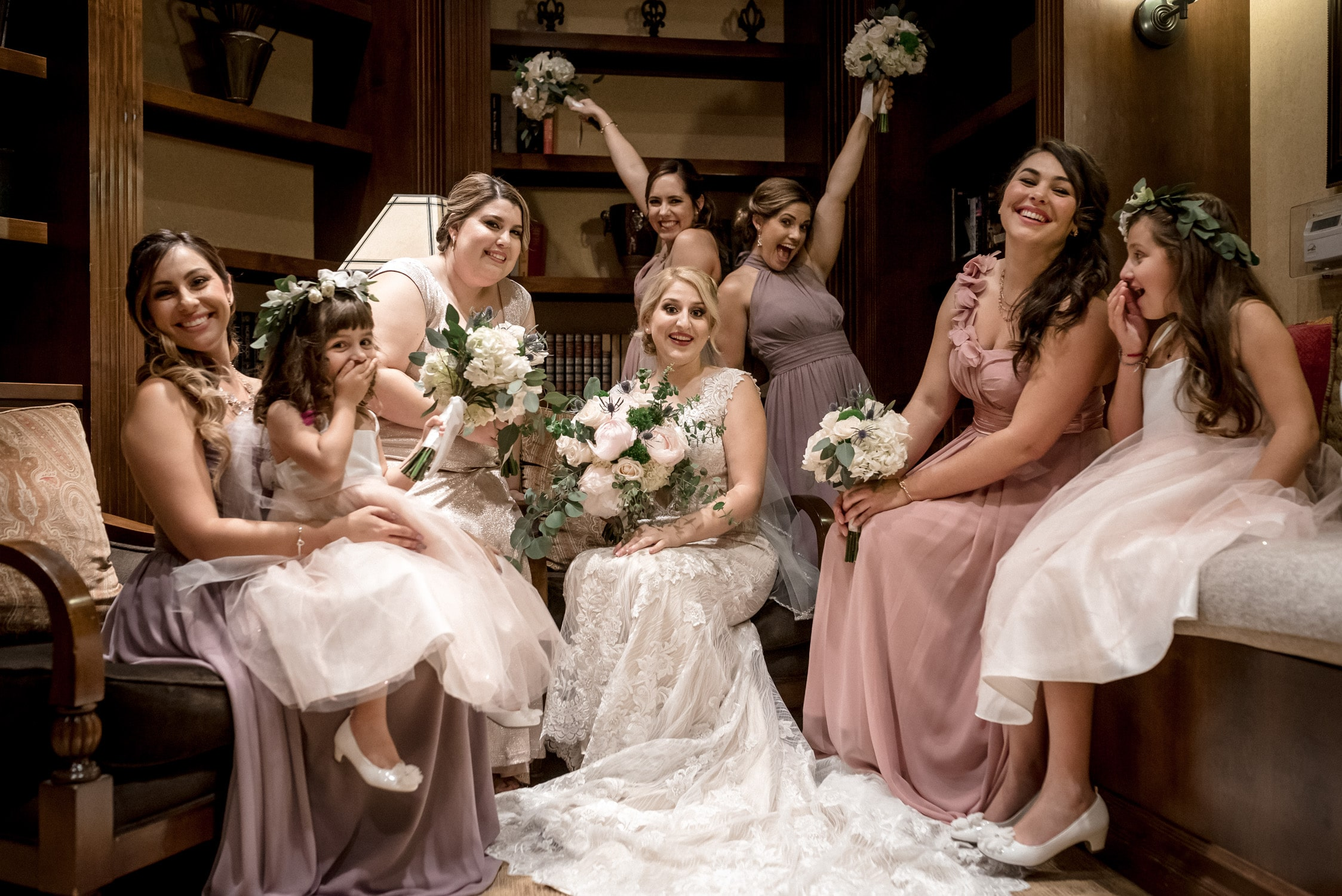 bridesmaids encouraged by Palm Springs Wedding Photographer to have fun posing