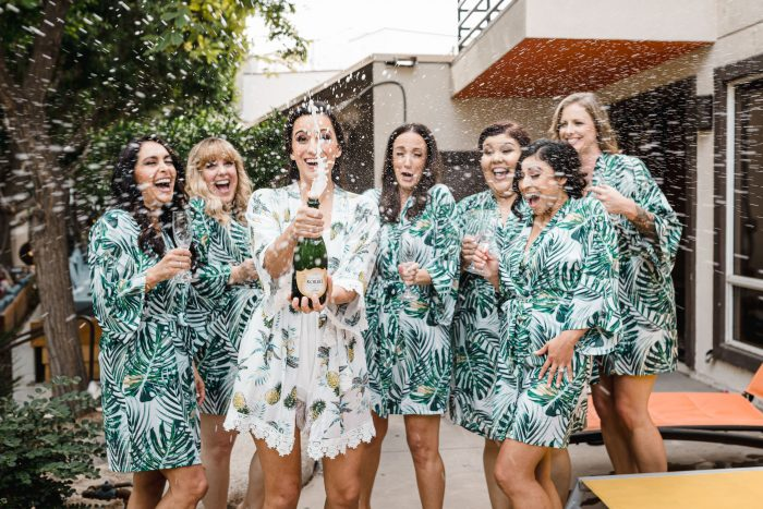bride and bridesmaids champaign pop in Palm Springs